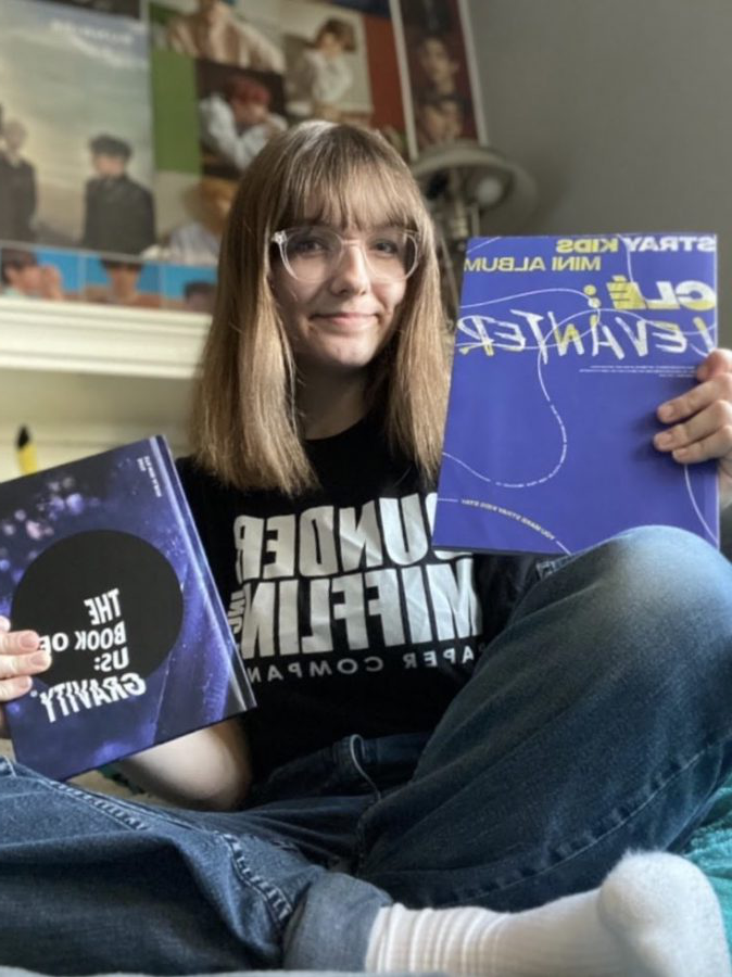 Bowling poses with some of her favorite albums from the groups Stray Kids and Day6.